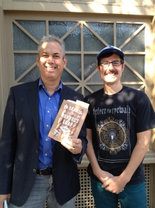 Host Chris Seigel with Sam Fromartz holding his book
