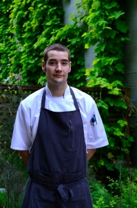 Chef Wesley Johnson standing outside Cafe Castagna